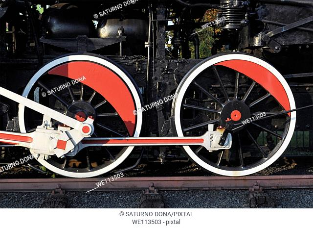 Red and white wheel of an old steam engine train