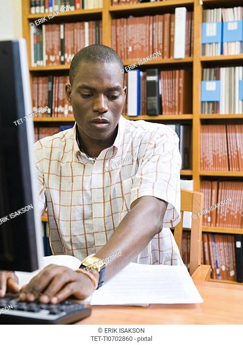 College student working in library