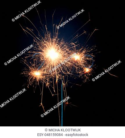 Sparkler isolated on a solid black background, 2019, happy newyear!