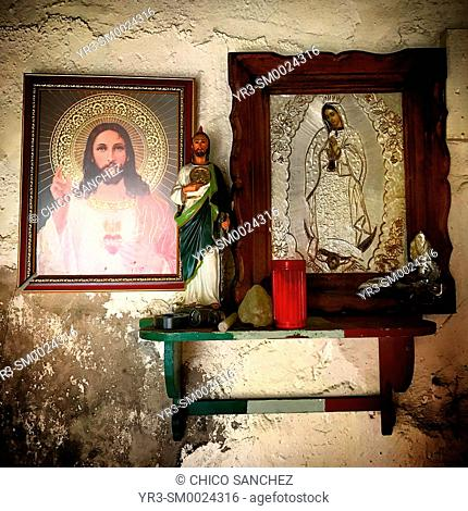 Images of Jesus Christ, Saint Jude Thaddeus and Our Lady of Guadalupe decorate a home in Puebla, Mexico