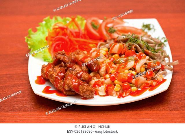 plate of chinese noodles with roasted meat and vegetables