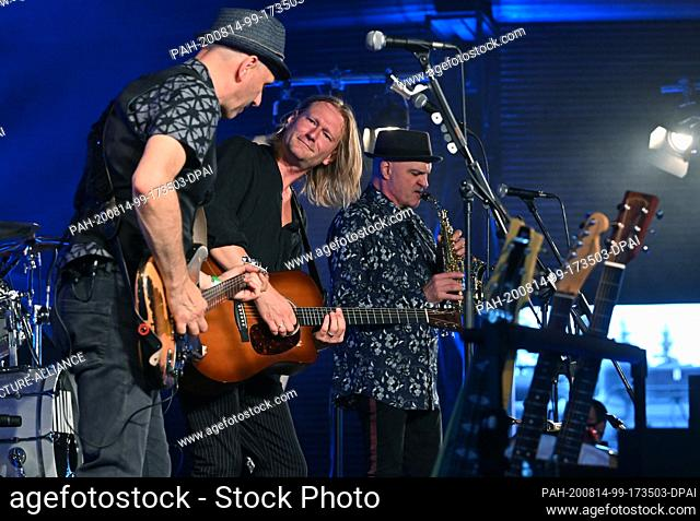 14 August 2020, Saxony, Chemnitz: The former Gerhard-Gundermann-Band Die Seilschaft with singer Christian Haase (2nd from left) plays in the scenery of the...