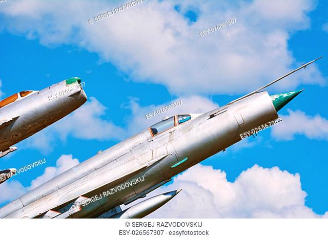 Two Military Airplanes against the Cloudy Sky