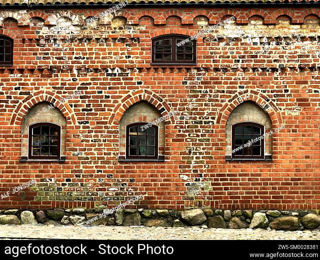 Five windows in a n old brick wall in a house from 16th centyry in Ystad, Scania, Sweden, Scandinavia