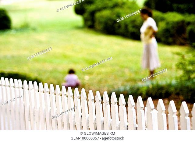 Side profile of a woman with her child in a lawn