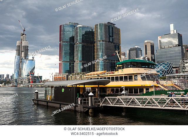 Sydney, New South Wales, Australia - View from Pyrmont Bay ferry wharf at Darling Harbour of the Crown Sydney skyscraper still under construction and the new...