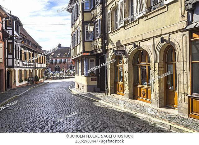 pavement street with old houses and half-timbered architecture in the village Barr, on the Wine Route of Alsace, France