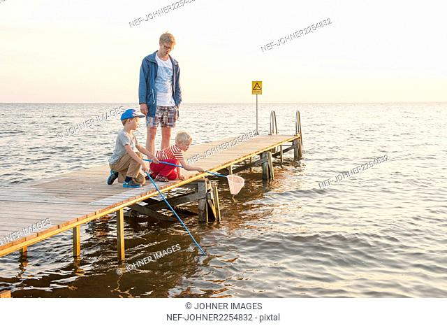Father with sons on jetty