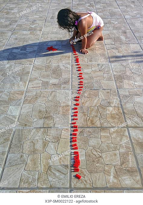 Little girl playing with letters