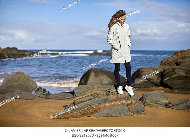 Young woman, Beach, Mutriku, Gipuzkoa, Basque Country, Spain