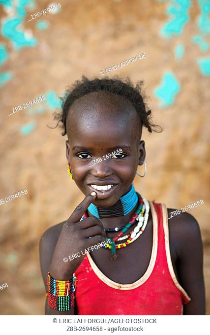 Ethiopia, Omo Valley, Turmi, portrait of a smiling hamer tribe girl