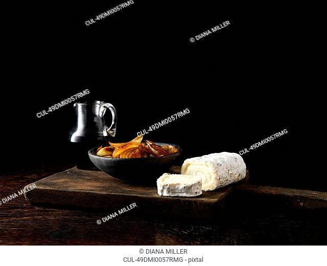 Onions cheese and wine on board