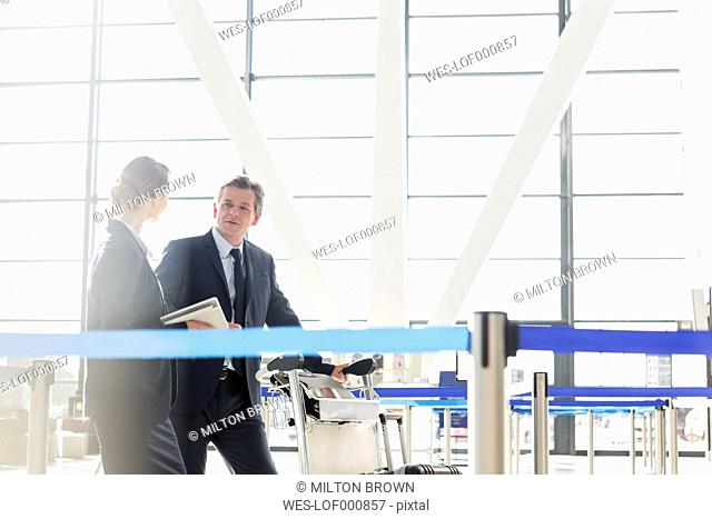 Businessman and businesswoman at the airport