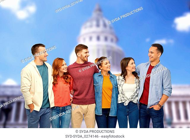 group of smiling friends over capitol building