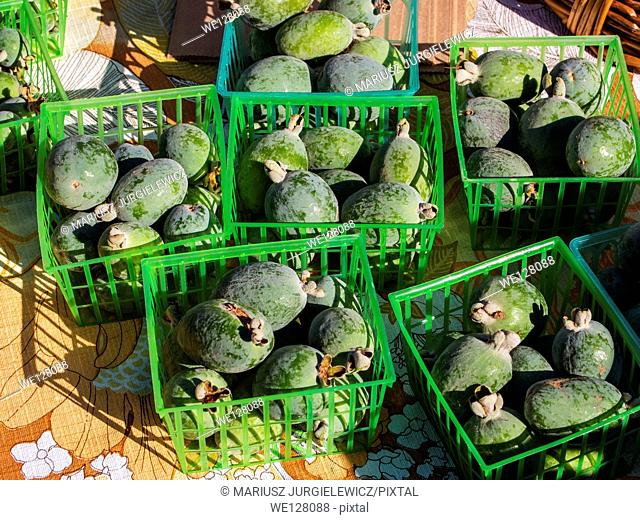 Baskets of fresh pineapple guava for sale at local farmers market