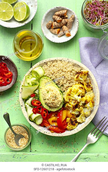 Buddha bowl (vegan) with quinoa, avo, hummus, baked cauliflower and pepper