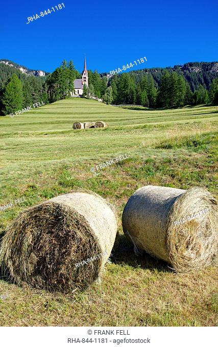 Church and hay bales, Vigo di Fassa, Fassa Valley, Trento Province, Trentino-Alto Adige/South Tyrol, Italian Dolomites, Italy, Europe