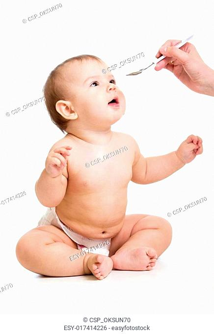 hand feeding baby with a spoon