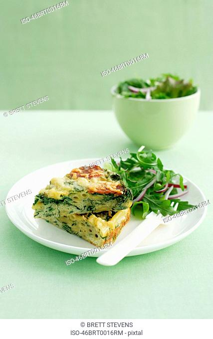 Plate of frittata with salad
