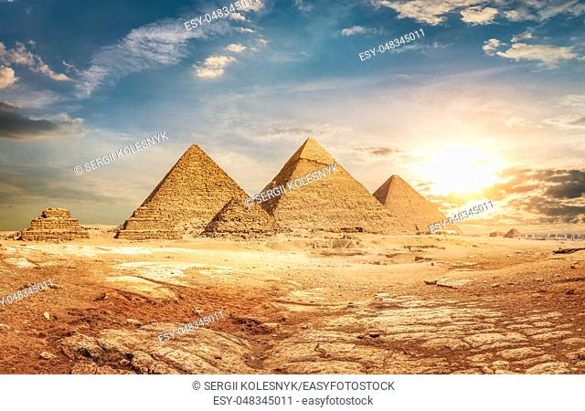 Egyptian pyramids in sand desert and sky