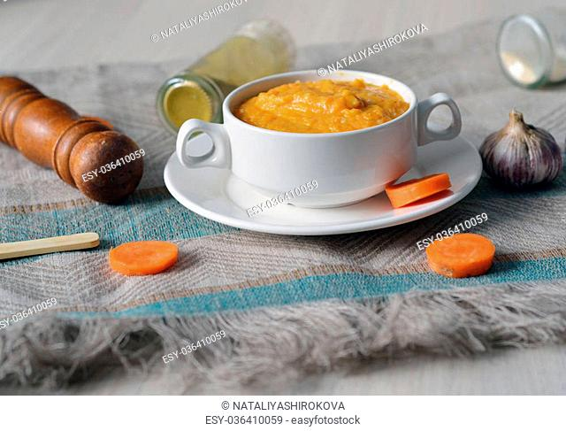 Tasty hot vegetable carrot soup in a bowl