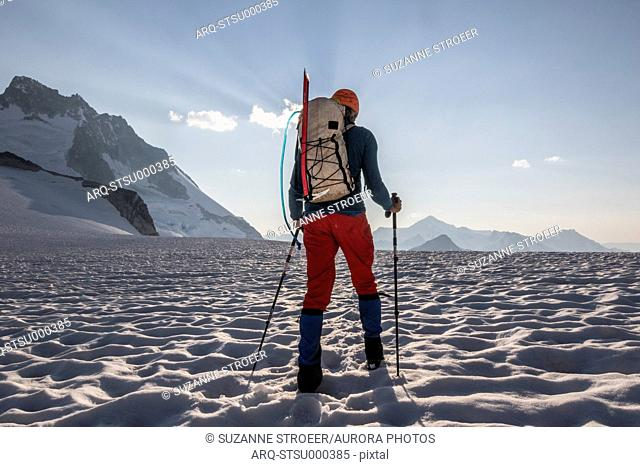 Mountain climber crossing Vowell Glacier, Bugaboo Mountains, British Columbia, Canada