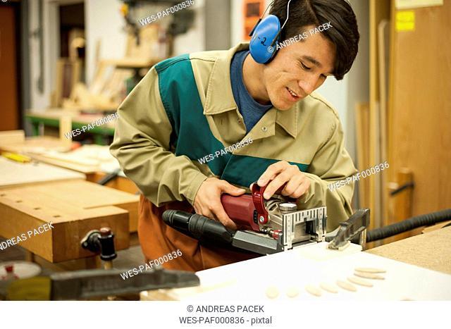 Vocational school student working in a carpenter's workshop
