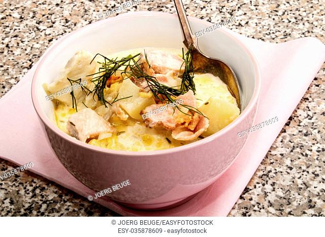irish fish soup with bacon and dill in a bowl