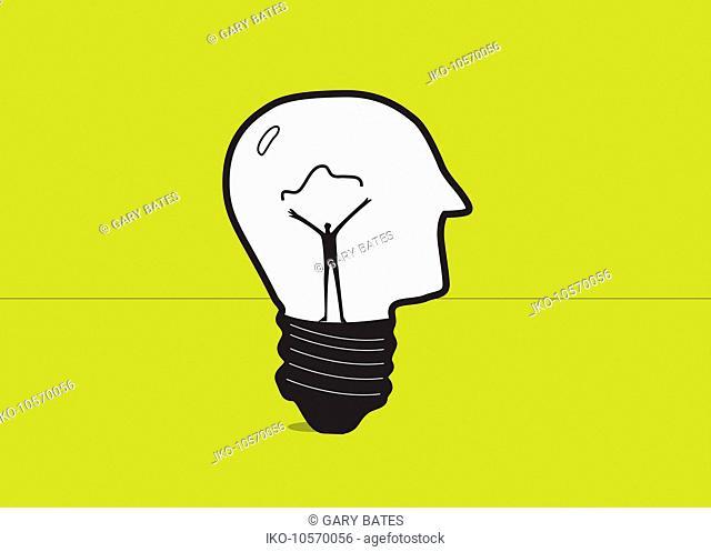 Man forming electric filament inside of human head light bulb