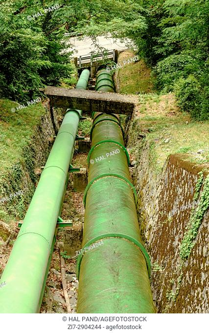 detail of water pipelines in woods servicing an hydroelectric production plant, shot near Verres, valley Aosta, Italy
