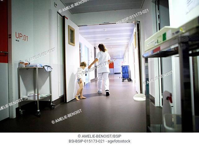 Reportage in the pediatric emergency unit in a hospital in Haute-Savoie, France. A nurse with a young patient