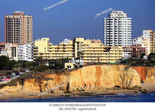 View from Ponta João de Arens of Praia do Vau and Praia dos Careanos, hotels and apartment buildings on cliffs above beaches, coast in Portimão, Faro district