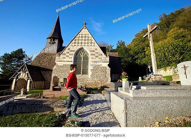 9-year-old boy in a village graveyard