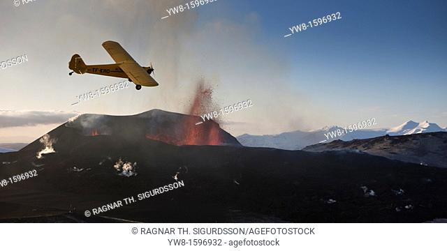 Small plane flying over Eyjafjallajokull Eruption, Iceland 2010