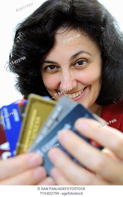 woman holding credit cards smiling