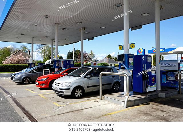 cars at a filling station forecourt pumps in northern ireland