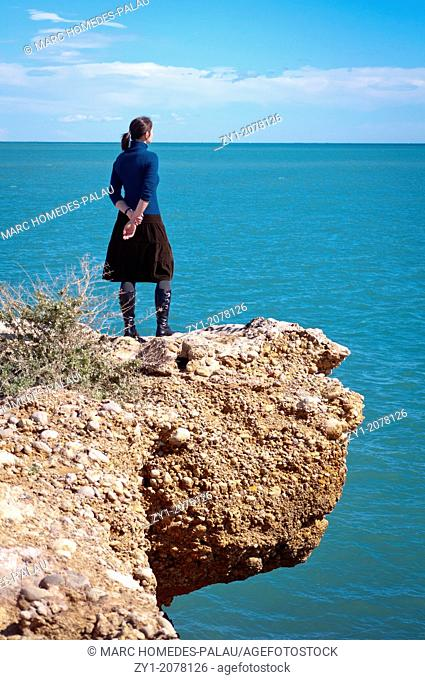 Pensive woman in Vinaroz coast Spain