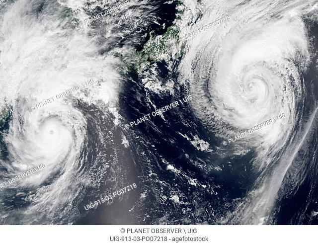 Satellite view of Typhoons Goni and Atsani in 2015 over the Pacific Ocean. Image taken on August 24, 2015