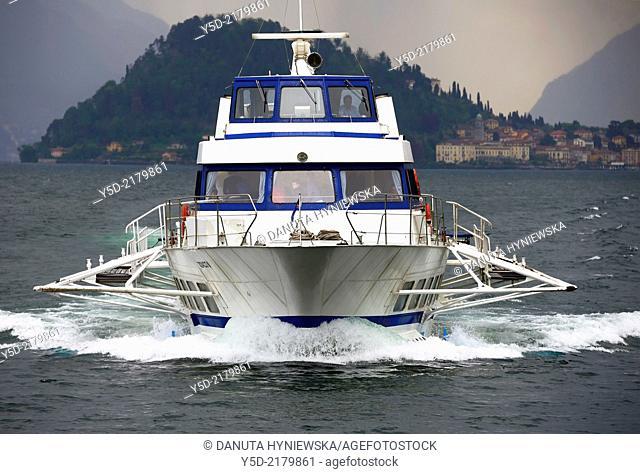 Hydrofoil boat approaches Menaggio from Bellagio, Bellagio in far background , Lake Como, Lombardy, Italy