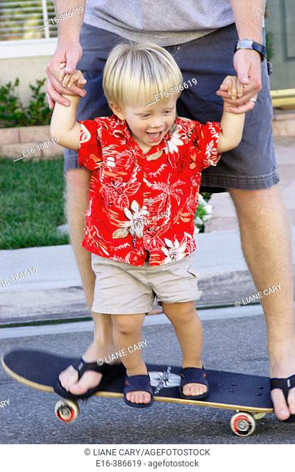 father and son on skateboard together