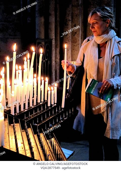 Candles lighting at the Cathedral Notre Dame, Rouen, Normandy, France