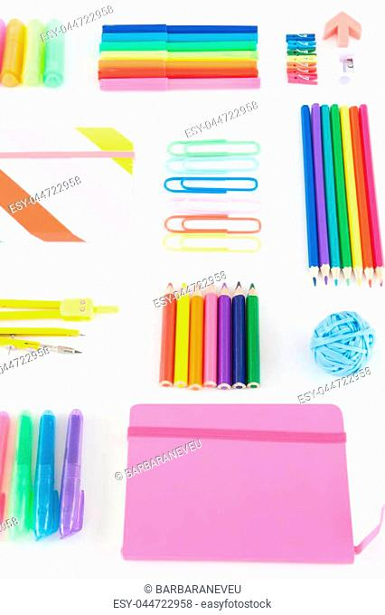Variety od school supplies in bright rainbow colors