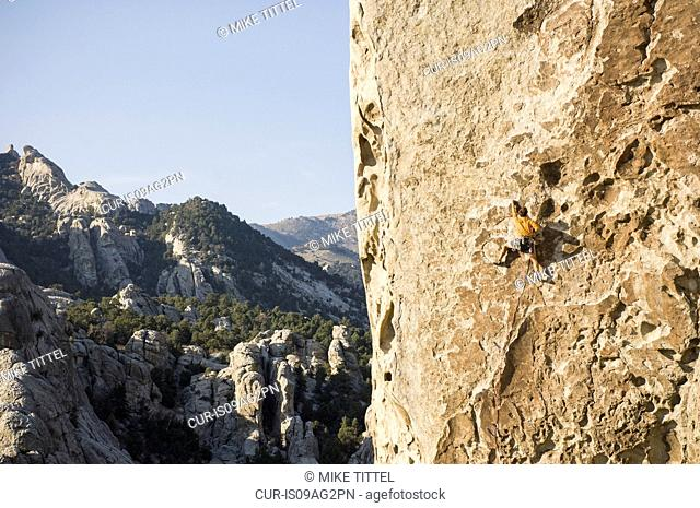 Man climbing Tribal Boundaries 5.10a - Flaming Rock, City of Rocks, Idaho, USA