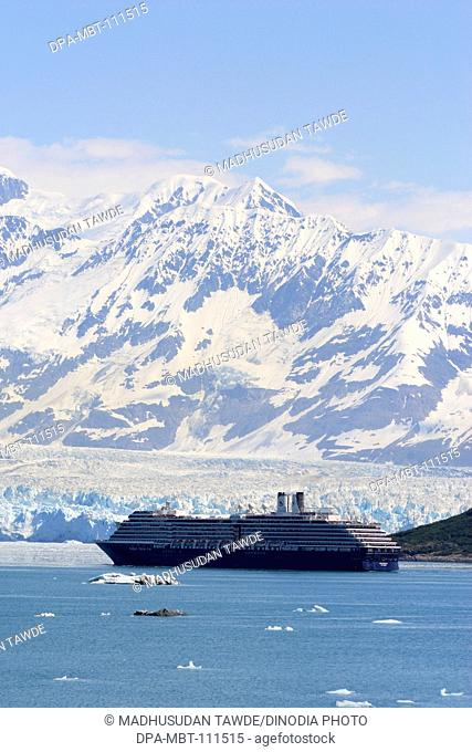 Oosterdam cruise ship in front of Hubbard glacier and Saint Elias mountain; The longest tidewater glacier in Alaska ; Saint Elias  national park ;...