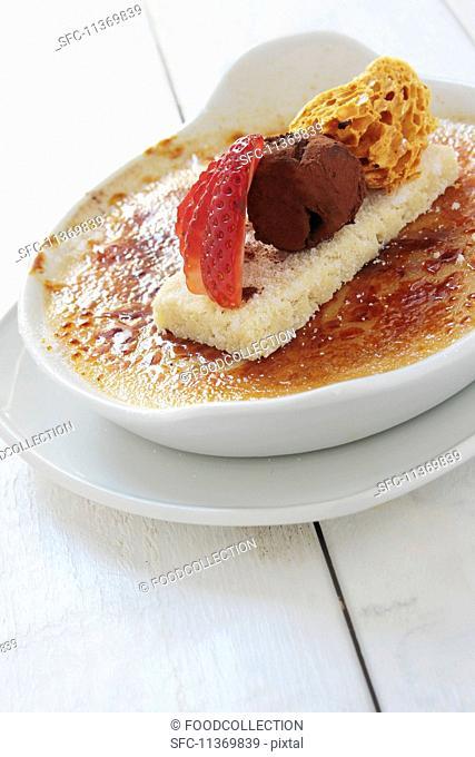 Crème brûlée with strawberries, truffle praline and honeycomb
