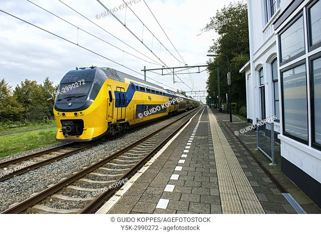 Arnemuiden, Netherlands. Intercity train arriving at a small, little intercity railroad station. The Netherlands had one of the most dense railway systems of...