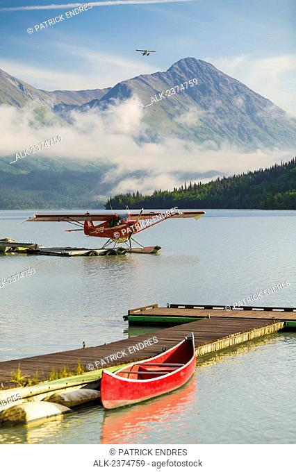 Float plane on Bear Lake, Moose Pass, Kenai Peninsula; Alaska, United States of America