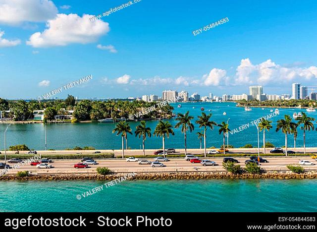 Miami, FL, United States - April 28, 2019: Causeway from downtown to Miami beach, Biscayne Bay and Star, Palm and Hibiscus Islands in Miami, Florida