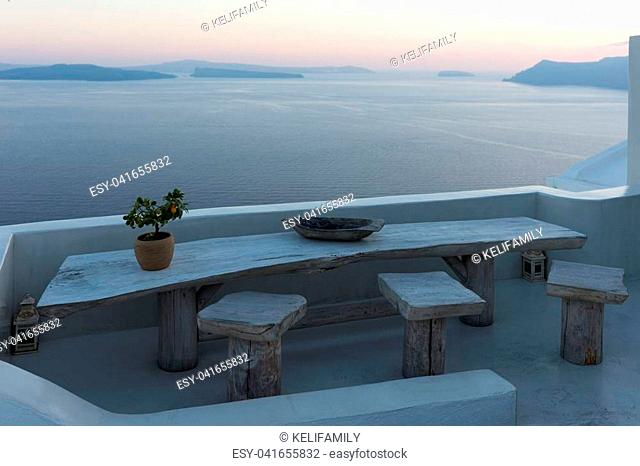 Terrace with view of the Mediterranean Sea in Oia, Santorini, Greece