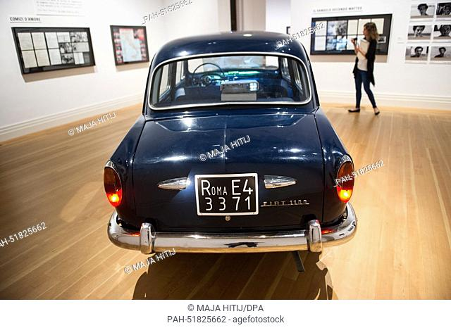 """A Fiat 1100 car onto which scenes from 'Love Meeting' (1964) by Pier Paolo Pasolini are projected stands in the exhibition """"""""Pasolini Roma"""""""" at..."""